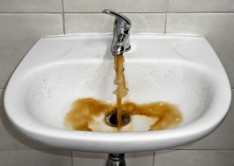 bathroom sink dispensing brown colored water
