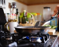 Cooking over a stove top, Joshua Resnick/shutterstock.com
