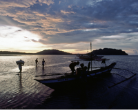Villagers returning home as the sun sets in the Philippines (Source: UN Photo/Od